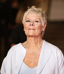 July 15, 2015 - London, UK - Photo filed Wednesday 15th July 2015. More than two dozen figures from the world of arts and entertainment have called on the Prime Minister to protect the BBC from cuts to its service...Bond stars Daniel Craig and Dame Judi Dench are among the 29 signatories of an open letter calling for ''a strong BBC at the centre of British life''. Source - BBC Judi Dench nominated  best leading actress for the Oscars 2014...British actress Dame Judi Dench arrives at the World Premiere of her latest James Bond film 'Skyfall', Royal Albert Hall, London, October 23, 2012. (Credit Image: © Max Nash/i-Images/ZUMA Wire)