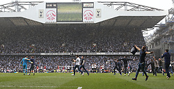 14 May 2017 London : Prmier League Football - Tottenham Hotspur v Manchester United :<br /> a fan gets onto the pitch to hug Hugo Lloris as the pitch invasion commences.<br /> Photo: Mark Leech