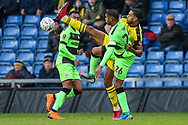 Forest Green Rovers Reuben Reid(26) and Oxford United's Curtis Nelson(5) challenge for the ball during the The FA Cup 1st round match between Oxford United and Forest Green Rovers at the Kassam Stadium, Oxford, England on 10 November 2018.
