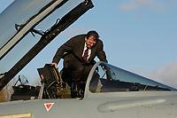 """03 NOV 2003, LAAGE/GERMANY:<br /> Gerhard Schroeder, SPD, Bundeskanzler, klettert in das Cockpit eines Eurofighter EF 2000 """"Typhoon"""", hier in der zweisitzigen Ausbildungsversion, dem neuen Jagdflugzeug der Bundesluftwaffe, im Rahmen eines Besuches der Luftwaffe, Jagdgeschwader 73 """"Steinhoff"""", Fliegerhorst Laage<br /> IMAGE: 20031103-01-039<br /> KEYWORDS: Bundeswehr, Bundesluftwaffe, Jet, Kampfflugzueg, Gerhard Schröder"""