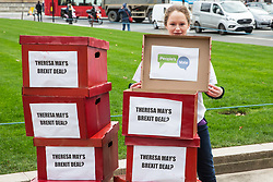 """London, UK. 14th January, 2019. 'Deal or No Deal' boxes reading """"Theresa May's Brexit deal?"""" on the outside and """"People's Vote"""" on the inside brought by activists from People's Vote UK to Parliament Square. A vote on Prime Minister Theresa May's proposed Brexit withdrawal agreement is due to be held in the House of Commons on 15th January."""