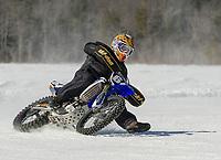 Racing around the plowed track on Lily Pond.  (Karen Bobotas Photographer)