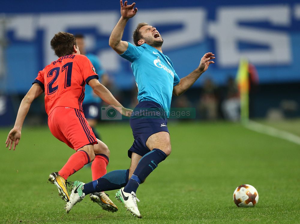 September 28, 2017 - Saint Petersburg, Russia - Jon Bautista of FC Real Sociedad (L) and Branislav Ivanović of FC Zenit Saint Petersburg vie for the ball during the UEFA Europa League Group L football match between FC Zenit Saint Petersburg and FC Real Sociedad at Saint Petersburg Stadium on September 28, 2017 in St.Petersburg, Russia. (Credit Image: © Igor Russak/NurPhoto via ZUMA Press)
