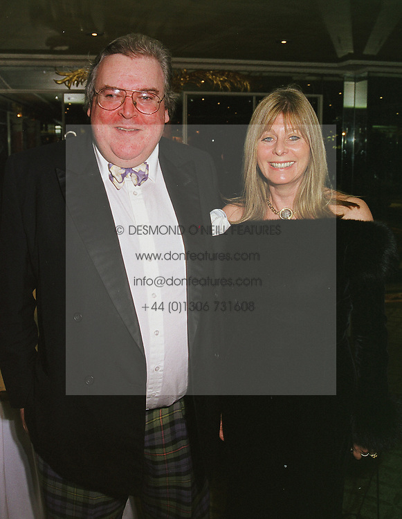 The HON.JOHN & MRS HESKETH, at a ball in London on 2nd March 1999.MOY 9