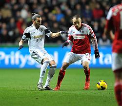 Swansea City's Chico passes the ball away from Fulham's Dimitar Berbatov - Photo mandatory by-line: Alex James/JMP - Tel: Mobile: 07966 386802 28/01/2014 - SPORT - FOOTBALL - Liberty Stadium - Swansea - Swansea City v Fulham - Barclays Premier League