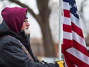 14 DECEMBER 2019 - DES MOINES, IOWA: TOM GEESAMAN, Ride Captain with the Patriot Guard Riders, at the ceremony to mark the laying of Christmas wreaths on veterans' graves. Volunteers working with Wreaths Across America placed Christmas wreaths on the headstones of more than 600 US military veterans in Woodland Cemetery in Des Moines. The cemetery, one of the first in Des Moines, has the graves of veterans going back to the War of 1812.    PHOTO BY JACK KURTZ