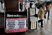 As the Coronovirus pandemic takes hold across the UK, with health authorities reporting cases rising from 25 to 87 in a single day, and resulting in the UKs chief medical officer Prof Chris Whitty announcing that an epidemic in the UK was highly likely, Londoners pass-by Evening Standard headlines at Victoria in central London, on 4th March 2020, in London, England.