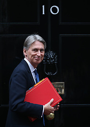 © Licensed to London News Pictures. 21/10/2015. London, UK. Foreign Secretary Philip Hammond arrives at Number 10 Downing Street before Prime Minister David Cameron welcomed Chinese President Xi Jinping. Photo credit: Peter Macdiarmid/LNP