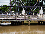 09 AUGUST 2018 - PHETCHABURI, PHETCHABURI, THAILAND: The Phetchaburi River flowing through Phetchaburi town. The river is about a meter below flood stage. The Phetchaburi River flows from Kaeng Krachan Dam to the Gulf of Siam through several towns including Ban Lat, Phetchaburi (the capital of Phetchaburi province) and Ban Laem. Government officials have warned residents of those towns that their towns will flood because the reservoir behind the dam is approaching capacity. Ban Lat and Phetchaburi could be flooded for several weeks. Residents of Ban Laem have been warned that their community could be inundated for over a month. Dams in Kanchanaburi province, west of Phetchaburi, are also approaching capacity and flooding is also expected in that area.   PHOTO BY JACK KURTZ