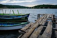 SANTIAGO DE CUBA, CUBA - CIRCA JANUARY 2020: Old wooden pier and boats in Cayo Granma in Santiago de Cuba