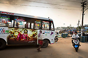 Coach full of Indian tourist arrives at the busy Vizhinjam harbour 28th February 2018 in Kovalam, Kerala, India.