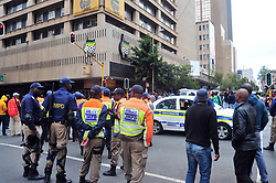 JOHANNESBURG, SOUTH AFRICA – APRIL 07: Police maintain a presence as MKMVA, ANCYL and ANC members gather outside Luthuli House in support of the ANC and Zuma amidst calls for President Zuma to step down, in Johannesburg, South Africa, 07 April 2017. Businesses closed and South Africans from numerous political, religious, labour and civic groups gathered at central points across the entire country protesting against President Zuma's recent government reshuffle appointing 10 new ministers and 10 new deputy ministers including the axing of the finance minister. Photo: Dino Lloyd