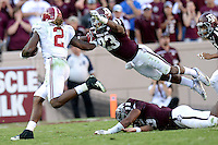 Alabama's Derrick Henry (2) stiff arms Texas A&M's Armani Watts (23) druing a first down run in the third quarter of a NCAA college football game on Saturday, Oct. 17, 2015 at Kyle Field in College Station, Texas.  (AP Photo/Sam Craft, The Bryan-College Station Eagle)