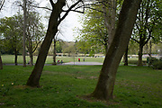 People out exercising responsibly and applying social distancing in Canon Hill Park as Coronavirus is felt on a local level on 12th April 2020 in Birmingham, England, United Kingdom. People here, in what is normally an incredibly busy urban park are mainly abiding the stay at home message, and those out exercising are doing so with care. Coronavirus or Covid-19 is a new respiratory illness that has not previously been seen in humans. While much or Europe has been placed into lockdown, the UK government has announced more stringent rules as part of their long term strategy, and in particular social distancing.