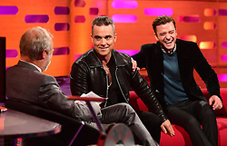 (left to right) Host Graham Norton, Robbie Williams and Justin Timberlake during filming of The Graham Norton Show at the London Studios in London, to be aired on BBC1 on Friday evening.