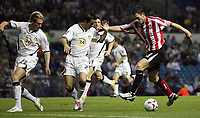Photo: Paul Thomas.<br /> Leeds United v Sunderland. Coca Cola Championship. 13/09/2006.<br /> <br /> Daryl Murphy (R) of Sunderland tries to go past Gary Kelly (C) and Matthew Kilgallon.