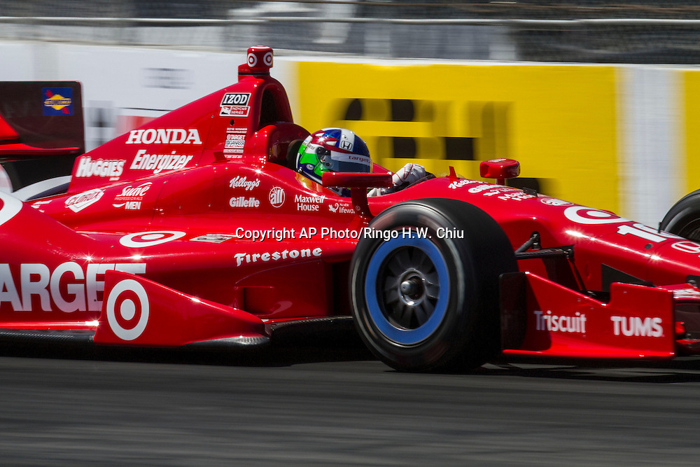 Dario Franchitti races during the IndyCar qualifying at the 39th Annual Toyota Grand Prix of Long Beach auto race Saturday, April 20, 2013, in Long Beach, Calif. Franchitti won the pole for the IndyCar series.  (AP Photo/Ringo H.W. Chiu)..
