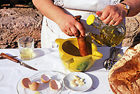 A Spanish woman making aiolli, essentially a strong mayonnaise with garlic, used as a condiment