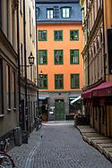 Stockholm, Sweden -- July 16, 2019. A vertical photo, taken down a side street in Stockholm.