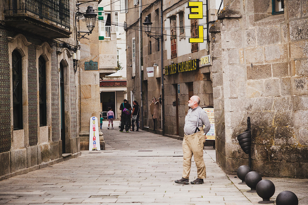 Karl Klaus walks the medieval streets of Bayona, Spain.