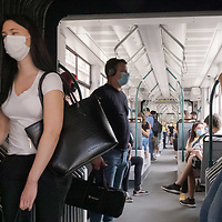 People wearing mask required as part of the COVID-19 preventive regulations travel on a subway in Budapest, Hungary on Sept. 23, 2020. ATTILA VOLGYI