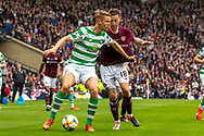 Kristoffer Ajer of Celtic shields the ball from Steven MacLean of Hearts during the William Hill Scottish Cup Final match between Heart of Midlothian and Celtic at Hampden Park, Glasgow, United Kingdom on 25 May 2019.
