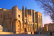 The Pope's Palace in Avignon with people walking in the square, Vaucluse, Rhone, Provence, France