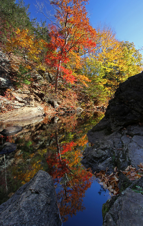 Glorious fall foliage photography reflection of this beautiful New England fall foliage scenery in Connecticut near East Haddam and at the bottom of Chapman warefall. Connecticut photography pictures are available as museum quality photography prints, canvas prints, acrylic prints or metal prints. Prints may be framed and matted to the individual liking and decorating needs:<br /> <br /> http://juergen-roth.artistwebsites.com/featured/glorious-connecticut-fall-foliage-juergen-roth.html<br /> <br /> Nature photography image capturing a glorious autumn reflection in the bottom pool of Chapman Falls during Connecticut peak fall foliage season. Chapman Falls is a beautiful 60 foot waterfall located in Devil's Hopyard State Park. There are a number of potholes, waterfalls and cascades that make this an inspiring destination for long exposure photography. The waterfall is surrounded by captivating autumn colors making it a favorite destination for leaf peepers and photographers alike.<br /> <br /> Good light and happy photo making!<br /> <br /> Juergen <br /> <br /> Fine Art Prints:  http://www.RothGalleries.com <br /> Image Licensing:  http://www.ExploringTheLight.com<br /> http://www.facebook.com/naturefineart <br /> @NatureFineArt