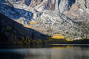 Small fishing boat on Convict Lake, fall, Inyo National Forest, California