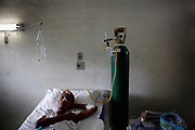Ivan Mesquita de Araujo, 42, lies in a bed in the MDR-TB patient unit in Raphael Hospital in Curicica. A former marvel cutter, de Araujo was first infected by tuberculosis in July 2007, received treatments. However, his condition did not improve, and he was finally diagnosed with MDR-TB in Sept 2008.