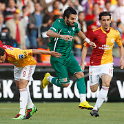Galatasaray's Elano BLUMER (L), Mehmet TOPAL (R) and Bursaspor's Volkan SEN (C) during their Turkish Super League soccer match Galatasaray between Bursaspor at the AliSamiYen Stadium at Mecidiyekoy in Istanbul Turkey on Sunday 25 April 2010. Photo by Aykut AKICI/TURKPIX