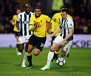 Watford's Etienne Capoue tussles with WBA's Jonny Evans during the Premier League match at Vicarage Road Stadium, London. Picture date: April 4th, 2017. Pic credit should read: David Klein/Sportimage