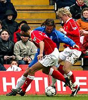 Photo. Chris Ratcliffe<br />Charlton v Birmingham. FA Premiership. 19/04/2003<br />Any way through, Christophe Dugarry tries to round Charlton's Mathias Svensson and Jonathan Fortune