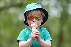 © Licensed to London News Pictures. 07/06/2021. London, UK. Two and half year old, Felix, enjoys an ice cream in Finsbury Park, north London, as the warm weather continues in the capital. According to the Met Office, a high of 24 degrees celsius is forecast for London and South East of England. <br /> <br /> ***Permission Granted***<br /> <br /> Photo credit: Dinendra Haria/LNP