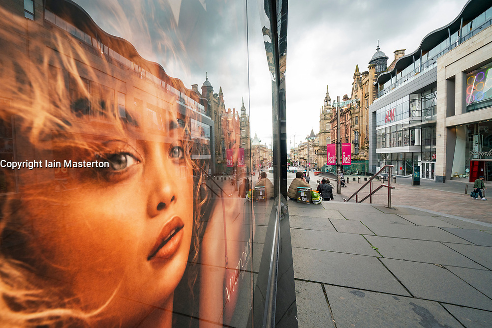 Glasgow, Scotland, UK. 27 June 2020. Reflection in shop window of Buchanan Street shopping precinct in Glasgow city centre. Shops are preparing to reopen on Monday 29 June following covid-19 lockdown restrictions. Iain Masterton/Alamy Live News.