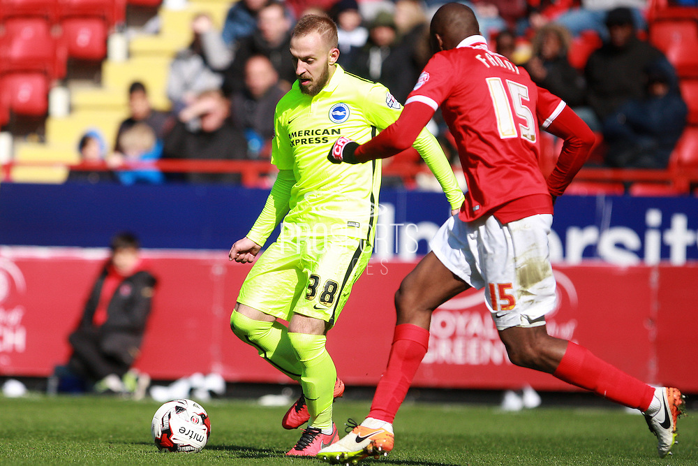 Brighton striker Jiri Skalak takes on Charlton Athletic defender Rod Fanni during the Sky Bet Championship match between Charlton Athletic and Brighton and Hove Albion at The Valley, London, England on 23 April 2016. Photo by Bennett Dean.