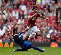 Photo: Jed Wee.<br />Manchester United v Seville. Pre Season Friendly. 12/08/2006.<br /><br />Manchester United's Cristiano Ronaldo (R) hurdles over a challenge from Seville's Daniel Alves.