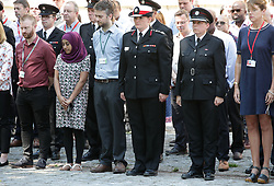 London Fire Brigade Commissioner Dany Cotton (centre) joins firefighters and LFB staff at Winchester House, in central London, to observe a minute's silence in memory of those people who died in last week's fire at Grenfell Tower.