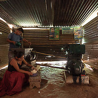 The corn mill in Concepción Actelá. People bring cooked maize to the mill where it is ground to make a dough for tortillas.