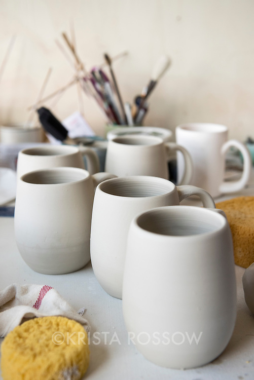 Unfinished porcelain ceramic pieces in the studio space of Laura Cooke at Clayspace. The Clayspace Co-op is a cooperative of professional ceramic artists located at the Wedge Studios at 119 Roberts Street in the River Arts District of Asheville, North Carolina.