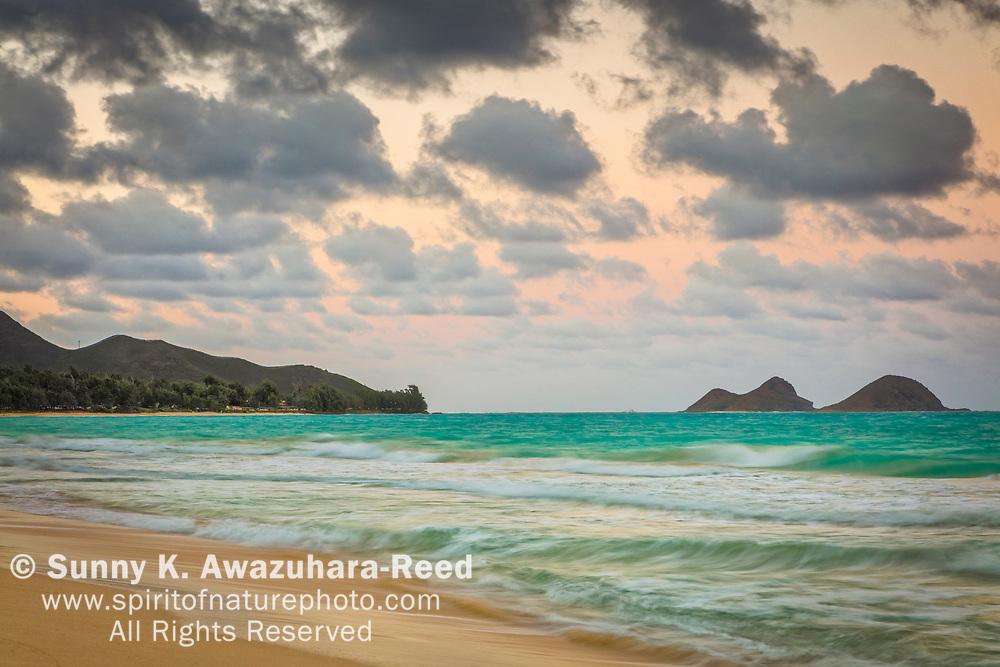 Mokulua Islands under pastel sky, Bellows Beach, Oahu Island, Hawaii.