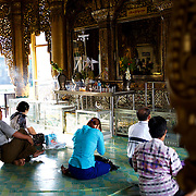 May 09, 2013 - Yangon, Myanmar: Buddhist devotees pray at Sule Pagoda in central Yangon. CREDIT: Paulo Nunes dos Santos