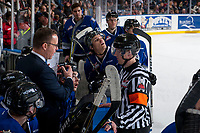 KELOWNA, CANADA - FEBRUARY 12:  Referee Mike Campbell stands at the bench and speaks to Victoria Royals' head coach Dan Price against the Kelowna Rockets on February 12, 2018 at Prospera Place in Kelowna, British Columbia, Canada.  (Photo by Marissa Baecker/Shoot the Breeze)  *** Local Caption ***