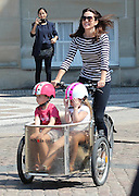 EXCLUSIVE<br /> Crown Princess Mary of Denmark with her twins – private bike tour in front of castle Amalienborg<br /> <br /> Crown Princess Mary of Denmark doesn't leave castle Amalienborg in Copenhagen in a limousine and with bodyguards but completely private on a tricycle and her two twins vincent and Josephine in a trailer. This sight leaves lots of tourists flabbergasted. The picture was taken May 10th, 2016 in Copenhagen, Denmark.<br /> ©Exclusivepix Media