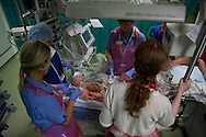 An anaesthetist and nursing staff receiving 10-day-old Finn Jones into the postnatal intensive care unit at Evelina London Children's Hospital immediately post-operation. The son of Philip and Kathryn Jones from Canterbury, Kent, Finn was born with a pre-diagnosed condition which required a life-saving, five-hour heart 'switch' operation to be carried out within the first two weeks of his life. The operation, which took place when Finn was 10 days old was successful, however, due to other near fatal complications the his recovery during the subsequent six weeks was slow and difficult.