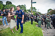 Legal observer talks to an officer about finding another way to end the standoff between the police and the residents. After a fatal police shooting of Alton Sterling last week, there have been multiple protests. At least 48 people had been were taken into custody by midnight Sunday,