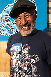Skateboarding legend Steve Caballero had some canvasses and a surfboard he painted in the art show area of the Surf City Blitz and RSD Moto Beach Classic. Huntington Beach, CA. Saturday October 27, 2018. Photography ©2018 Michael Lichter.