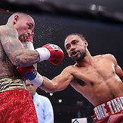 Keith Thurman (R) and Luis Collazo fight during their Premier Boxing Champions boxing match for the WBA Welterweight title on ESPN at the USF Sun Dome, on Saturday, July 11, 2015 in Tampa, Florida.  Thurman won the bout when the corner of Collazo stopped the fight at the beginning of the eighth round. (AP Photo/Alex Menendez)
