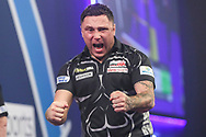 Gerwyn Price hits a double and celebrates winning the fifth set during the William Hill World Darts Championship Final at Alexandra Palace, London, United Kingdom on 3 January 2021.