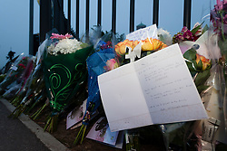 © Paul Thompson Licensed to London News Pictures. 29/04/2014. Corpus Christi College, Leeds, West Yorkshire uk.. Flowers left in memory of teacher Ann Maguire who was stabbed and killed by a 15 year old pupil. Photo credit : Paul Thompson/LNP